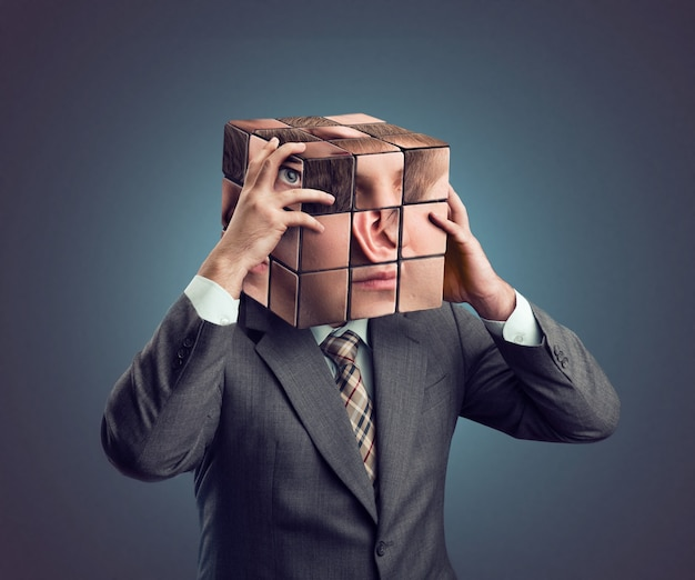 Businessman with rubik cube head