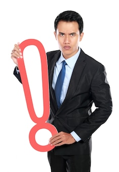 Businessman with a sign exclamation mark