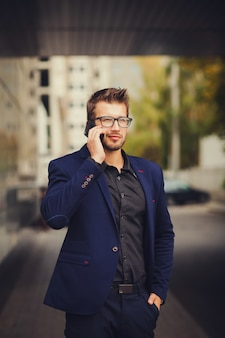 Businessman with smartphone talking