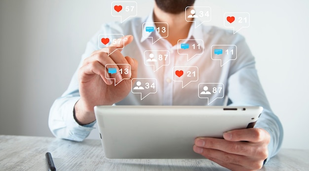 Businessman  with social media marketing in tablet screen