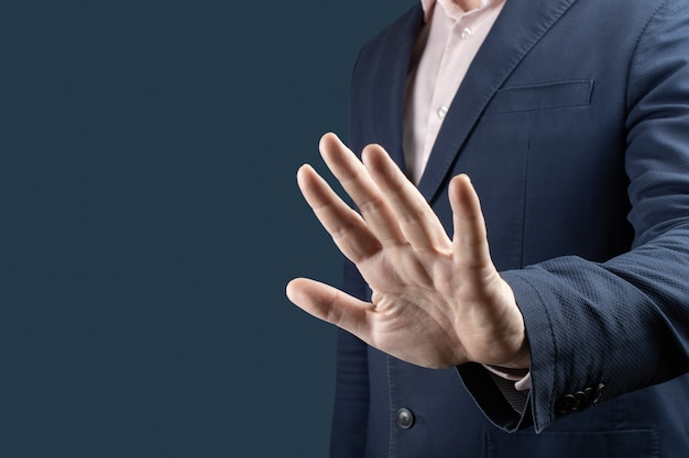 Businessman with stop gesture concept