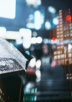 Businessman with umbrella in rainy city