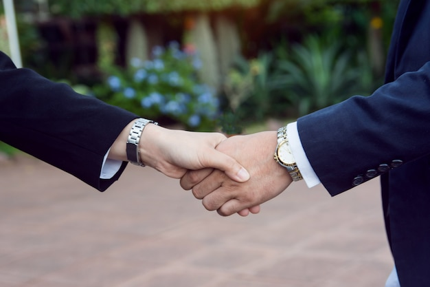 Businessman and woman shake hands after a business meeting
