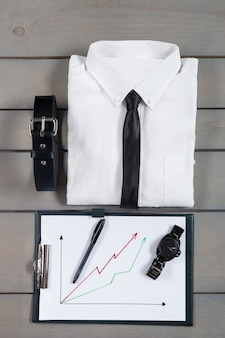 Businessman, work outfit on grey wood