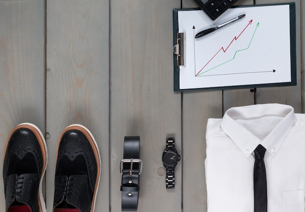 Businessman, work outfit on grey wooden.d calculator. back to work.