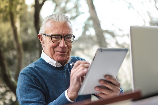 Businessman at work with tablet
