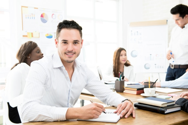 Businessman working in creative office with his colleagues
