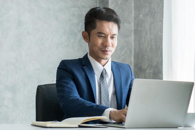 Businessman working on laptop.