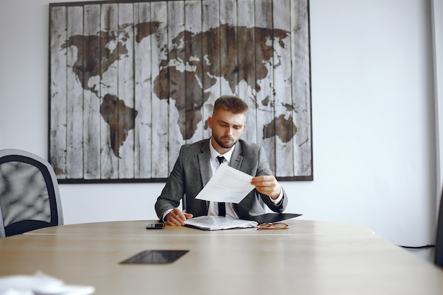 Businessman working in the office.man reads the contracts. guy is sitting in the office