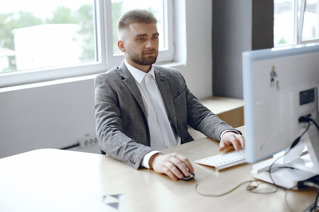 Businessman working in the office.man uses a computer. guy is sitting in the office