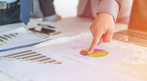 A businessman working plan the business and analysis many chart graph