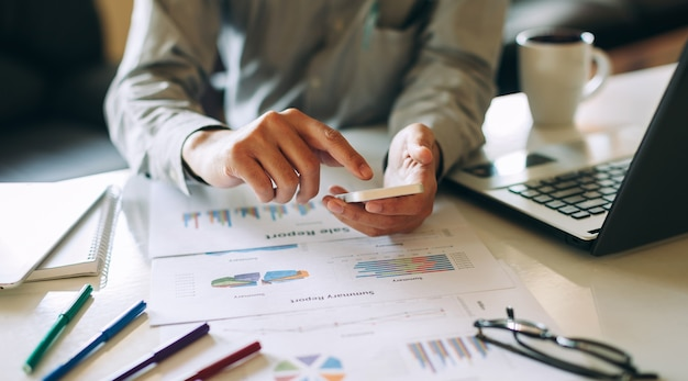 Businessman working on project for analyzing company financial report balance statement