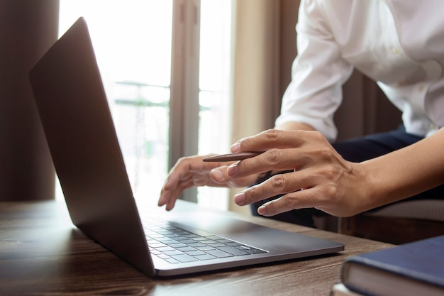 Businessman working and typing keyboard on laptop or computer