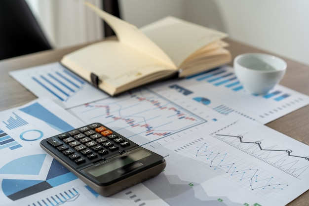 Businessman working using a calculator finance accounting concept achievement to balance man assistant accounting