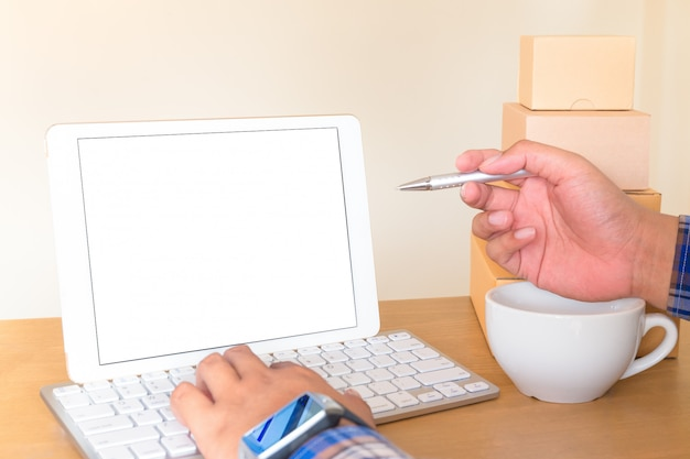 Businessman working with blank screen tablet.
