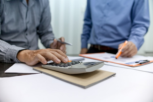 Businessman working with calculator. business people meeting at working with financial rep