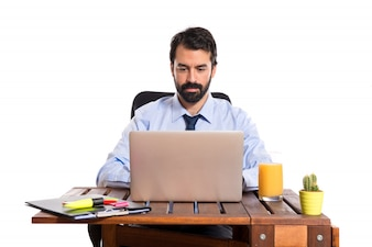 Businessman working with his laptop