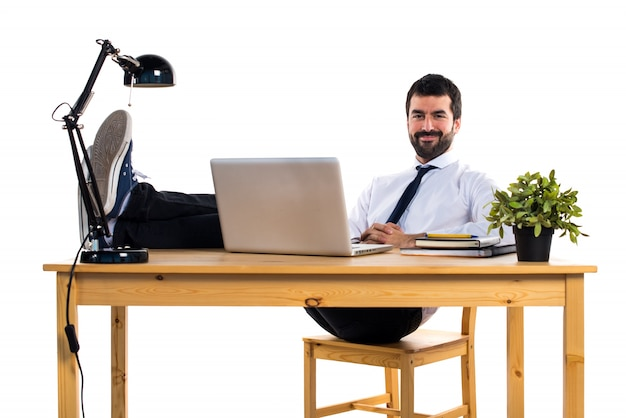 Businessman working with laptot in his office