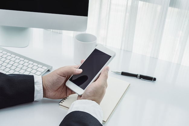 Businessman working with modern devices, computer and mobile phone