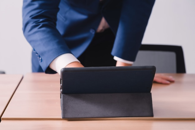 Businessman working with tablet in seminar room