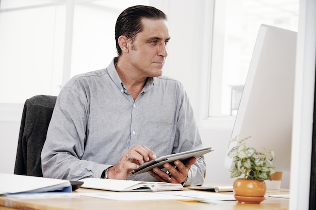 Businessman working with touchpad