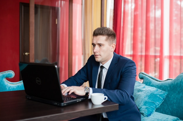 Businessman works with laptop