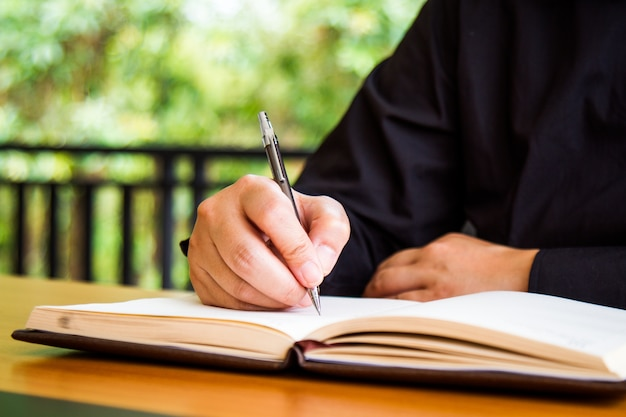 Businessman writing book