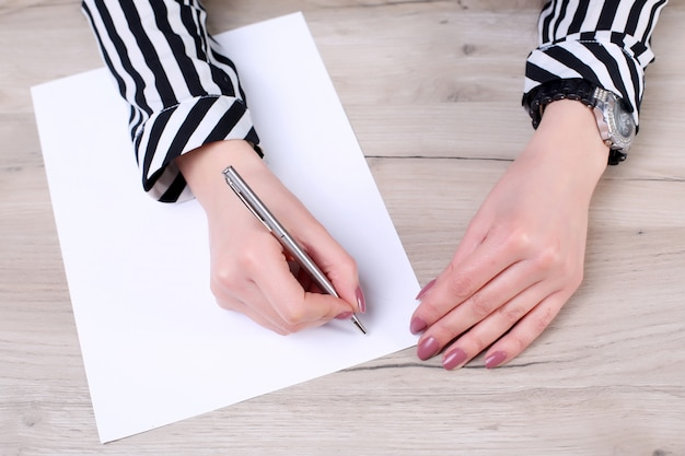 Businessman writing or drawing a note in a blank notebook