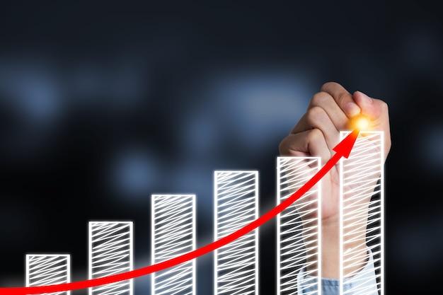 Businessman writing increase red arrow on bar chart