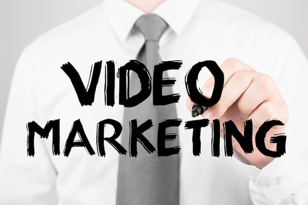 マーカー、ビジネスコンセプトで単語ビデオマーケティングを書くビジネス