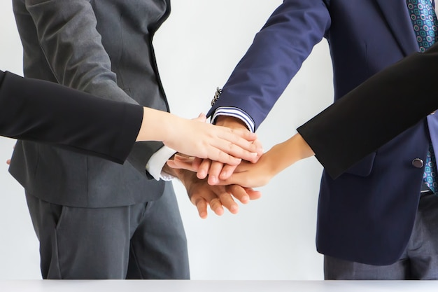 Businessmen are laying hands together in layers. concept, cooperation and unity in work