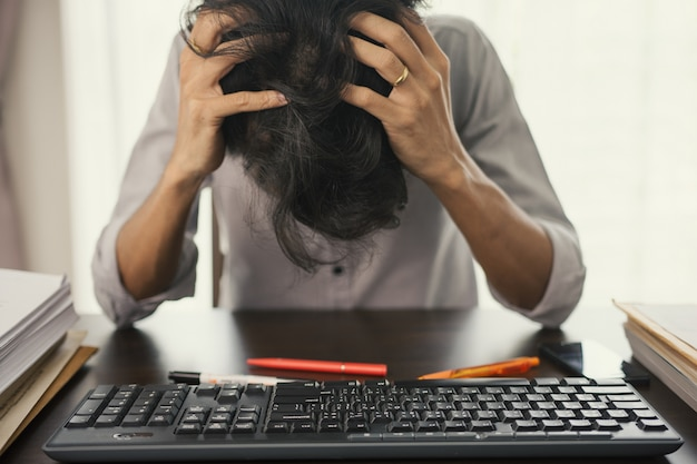 Businessmen are stressed with unfinished work