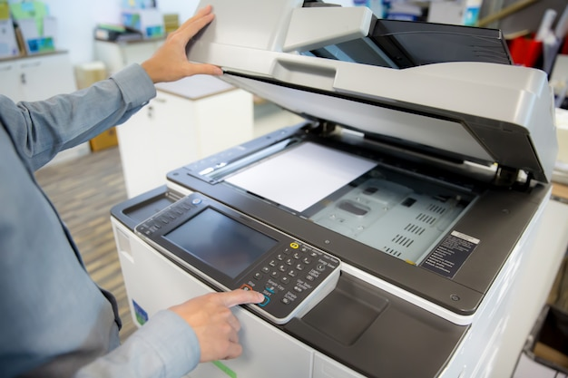 Businessmen are using photocopier.