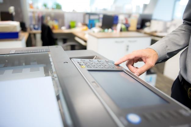 Businessmen are using photocopier.