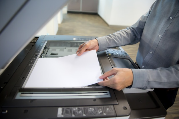 Businessmen are using photocopiers, scanner.