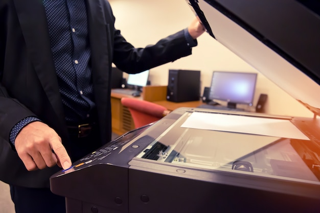 Businessmen are using photocopiers