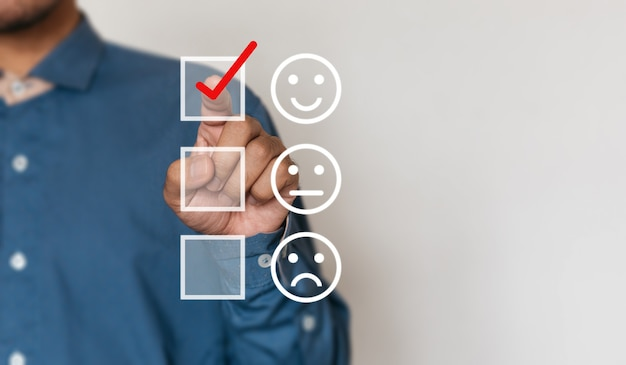 Businessmen choose to rating score happy icons with copy space. customer service experience and business satisfaction survey concept