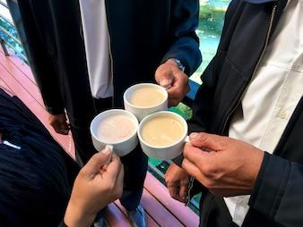 Businessmen clink coffee