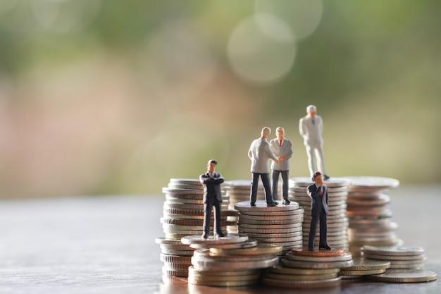Businessmen on coins