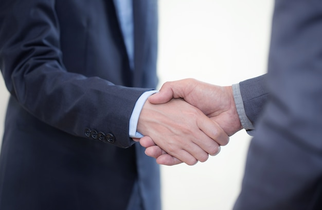 Businessmen cooperate after trade agreement. joint company