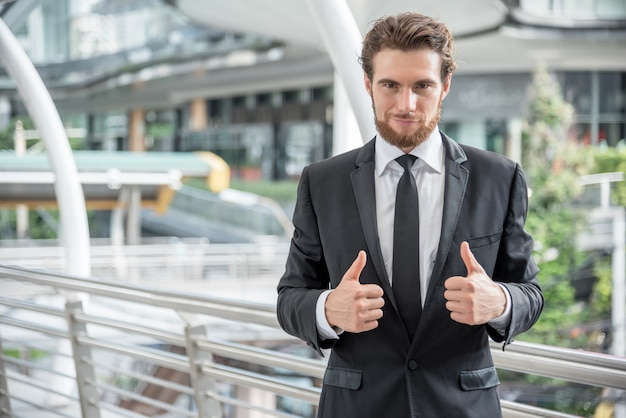 Businessmen give a thumbs-up, business concept, cheerful concept