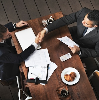 Businessmen handshake deal agreement concept