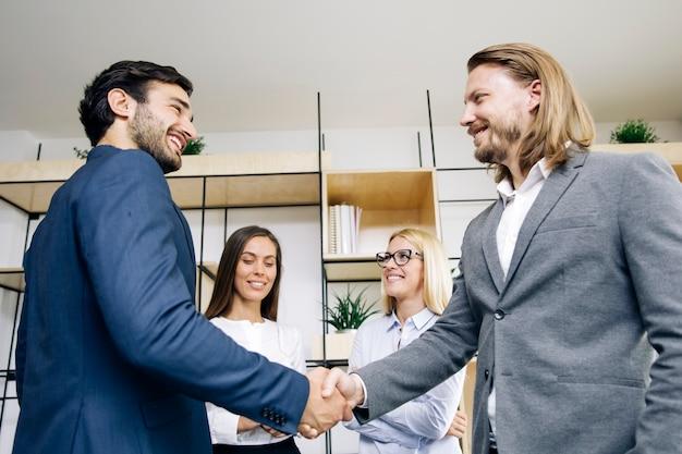 Businessmen handshaking after deal agreement