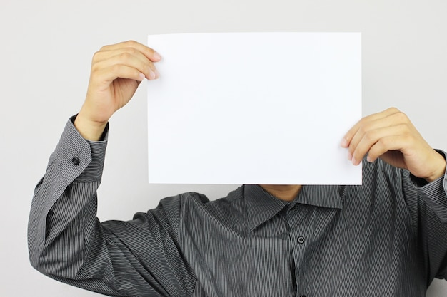 Businessmen hold blank white paper and have copy space.