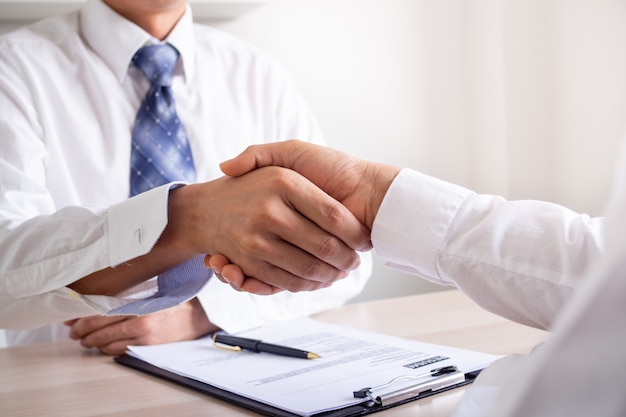 Businessmen join hands to recruit new employees to join the company work, agree to join.