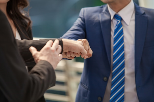 Businessmen making a fist bump