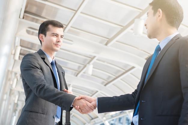 Businessmen making handshake