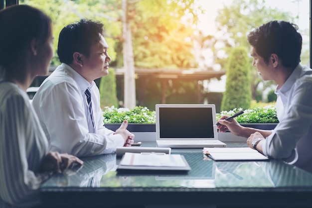 Businessmen negotiate terms and conditions before signing a business co-operation agreement