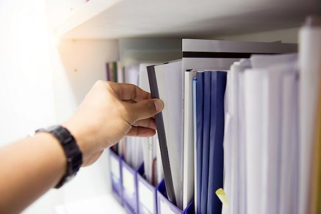 Businessmen people choosing documents.