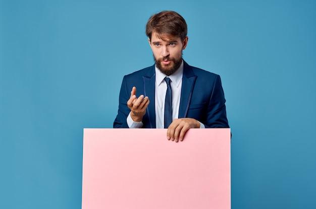 Businessmen pink mockup poster in hand blue background